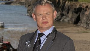 From: BUFFALO PICTURES IN ASSOCIATION WITH HOMERUN PRODUCTIONS for ITV1  DOC MARTIN on ITV1.  MARTIN CLUNES plays the curmudgeonly doctor in the award winning comedy drama for ITV1, Doc Martin. He plays the role of Dr Martin Ellingham, the grumpy GP whose truculent and tactless manner upsets the convivial community of Portwenn.  Picture shows: MARTIN CLUNES as Doc Martin  Copyright: Nicky Johnston/ITV  This photograph is (C) ITV Plc and can only be reproduced for editorial purposes directly in connection with the programme or event mentioned above, or ITV plc. Once made available by ITV plc Picture Desk, this photograph can be reproduced once only up until the transmission [TX] date and no reproduction fee will be charged. Any subsequent usage may incur a fee. This photograph must not be manipulated [excluding basic cropping] in a manner which alters the visual appearance of the person photographed deemed detrimental or inappropriate by ITV plc Picture Desk.  This photograph must not be syndicated to any other company, publication or website, or permanently archived, without the express written permission of ITV Plc Picture Desk. Full Terms and conditions are available on the website www.itvpictures.com
